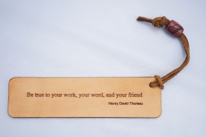 Leather bookmark laser engraved with wood bead turned on lathe and laser engraved image
